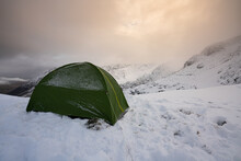 A Wild Camping Tent High In The Mountains Of Snowdonia In Wales UK With Winter Snow