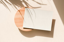 Card On Beige Background With Palm Leaves Shadows. Minimal Concept Mock Up Background.