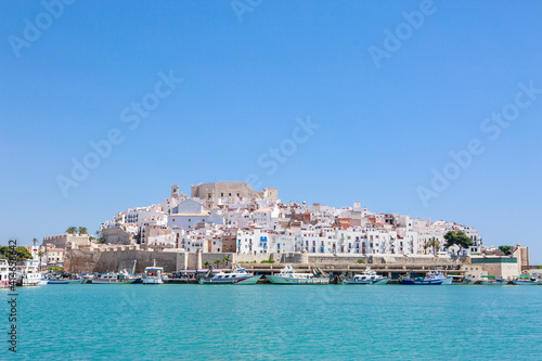 Beautiful village reflected on still water. Famous place Peniscola or Peñiscola on the Mediterranean. Templar Castle.