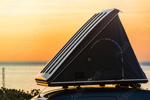 Car with roof top tent camp on beach Wallpaper Mural