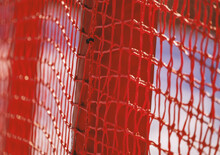 Red Safety Net At The Edge Of An Alpine Skiing Slope. Close Up Shallow Depth Of Field.