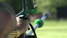 Aiming And Shooting A Recurve Bow, Archery Target Practice, Close Up Slow Motion Shot