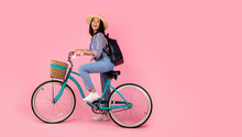 Excited Asian Woman Riding Retro Bicycle With Wicker Basket