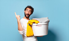 Young Crazy Bearded Man Housekeeping Washing Clothes
