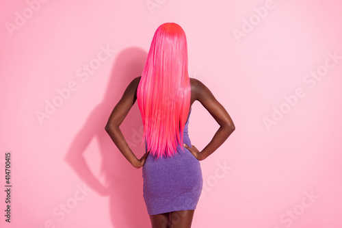 Fotografie, Obraz Photo portrait back view of african american woman with pink wig isolated on pas