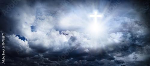 Valokuva Cross silhouette in cloudy sky, banner design
