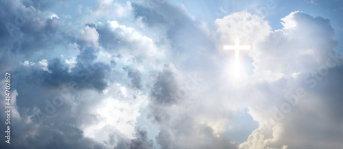 Fotografie, Obraz Cross silhouette in sky with clouds, banner design