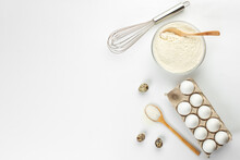 Eggs And Quail Eggs And Sugar, Coconut Shavings In Wooden Spoons