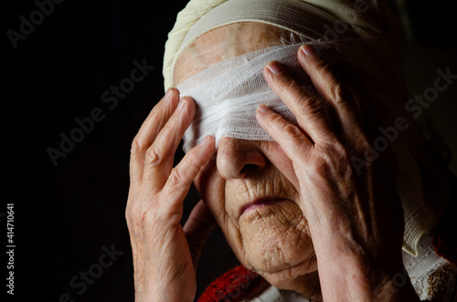 Foto Blindfold on the eyes of an old woman