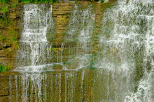 Water Cascading Off A Cliff And Down Rock Face In Upper New York State, USA