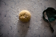 Above Shot Of Dough Ball Resting On The Kitchen Counter With Fork