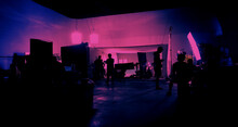 Behind The Scenes Of Shooting Video Production And Lighting Set For Filming Movie Which Film Crew Team Working In Silhouette And Professional Equipment In Studio For Video Online. Video Production Con