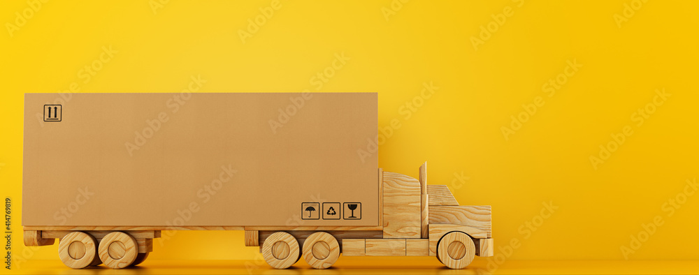 Fototapeta Big cardboard box package on a wooden toy truck ready to be delivered on yellow background