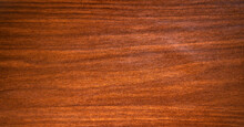 The Texture Is Mahogany With Stripes And Splotches Of Black Color