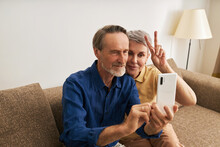 Senior Couple Taking A Selfie. Mature People Spending Time Together And Having Fun.