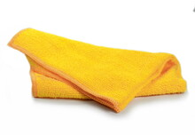 Yellow Micro Fiber Towel Isolated On White Background. Clean, New Yellow Microfiber Cloth Isolated On White Background
