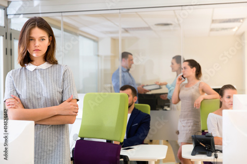 Tablou Canvas Portrait of young unhappy angry business woman in coworking space with working c