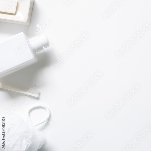 Fototapeta Spa bathroom products. Soap bar, toothbrush, shower ball sponge, shampoo bottle on white background. top view, copy space obraz na płótnie