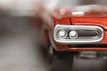 Close Up Shot Of Red Collectible Toy Car Head Lamps