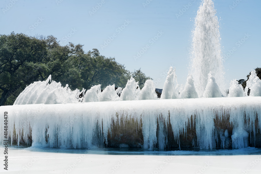 Fototapeta Mecom Fountainfountain froze over as a result of abnormal frost,  Houston, Texas, United States.