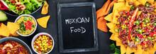 Hispanic Mexican Food, Nachos, Guacamole, Meat Tacos On Dark Background