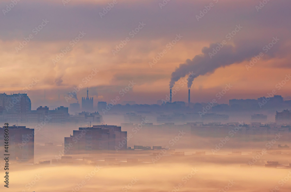 Fototapeta Urban industrial landscape, residential buildings buried in smoke and smog, chemical plants emit smoke into the atmosphere.