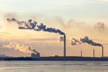 Smoke From Chimneys Of A Metallurgical Plant Near A Frozen Lake