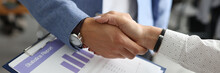 Closeup Of Man And Woman Shake Hands. Conclusion Of Contracts In The Office Concept.