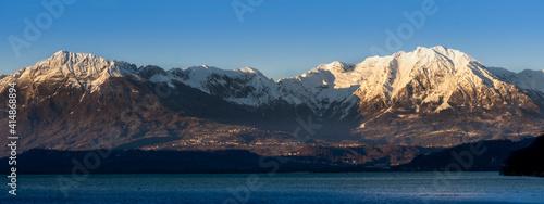 horizontal banner of snowy mountain passage with alpine lake and blue sky Fototapeta