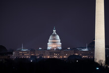 View Of The US Capitol Building And The Washington Monument At Night