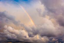 Luminous Rainbow In The Cloudy Sky