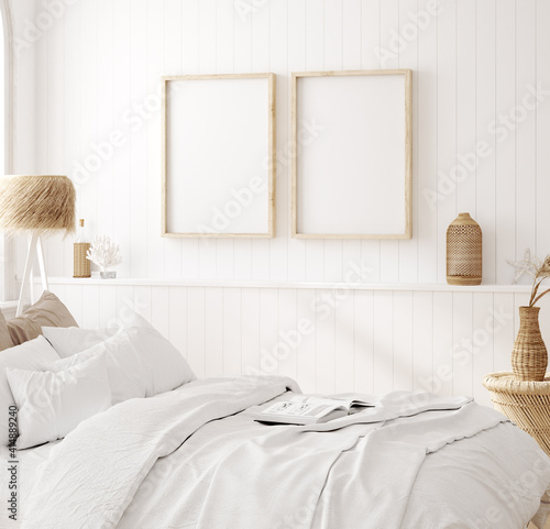 Fototapeta Mock up frame in cozy home interior background, coastal style bedroom, 3d render obraz