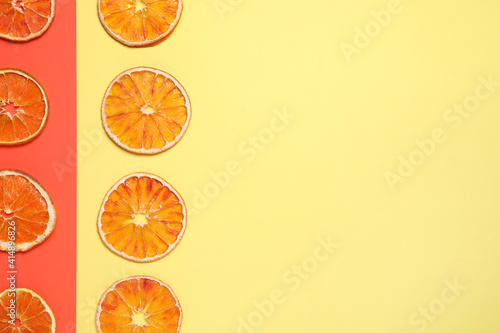 Fotografie, Obraz Delicious dried orange slices on color background, flat lay