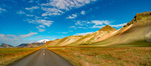 Panoramic View Over Asphalt Road Towards Snaefellsjoekull Mountain Volcano Peak And Icelandic Colorful And Wild Landscape At Summer Time And Blue Sky, Iceland.