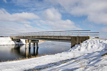 Zevenhuizen, The Netherlands, February 9, 2021: Beijing Bridge Crossing One Of The Frozen Canals Around King Willem Alexander Rowing Course On A Winter Day