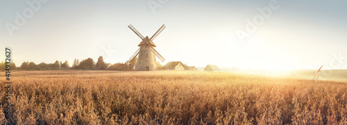 Rural landscape at dawn, terrain with oat fields and from the and a windmill and village on the hill. Raster illustration. - fototapety na wymiar