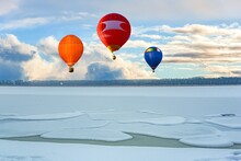 A Balloon Flies Against The Sky . Winter Landscape From A Height Of