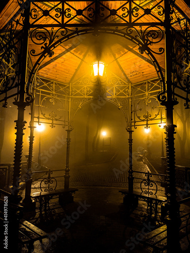 Fotografija Empty gothic alcove at night in the fog after the rain lighten up with warm yell