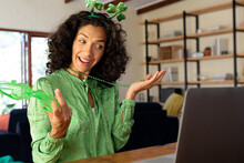 Caucasian Woman Dressed In Green With Shamrock Deely Boppers For St Patrick's Day Talking During Vid