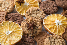 Chocolate, Ginger, Oatmeal Cookies, Slices Of Dried Oranges, Stars Of Anise Close-up. Aromatic And Delicious Sweet Pastries And Spices