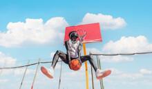Basketball Street Player Making A Rear Slam Dunk