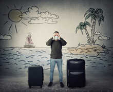 Man Wearing Face Mask, Keeps Hands To Forehead, Discouraged Due Vacation Cancellation. Fatigue Guy Has To Stay Home For Holiday As COVID-19 Virus Protection. Travel Ban, Cancelled Flight Departures