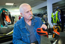 Senior Man In Motorsport Showroom