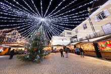 Christmas Market With Stalls Illuminated At Night At The Place Fernand Zeyer, Riquewihr, Alsace, France