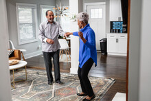African American Couple Dances In Living Room, Active Lifestyle Community