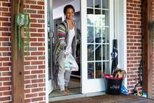 Black Woman Grabs Food Delivered To Front Door At Home