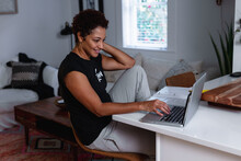 Creative Woman Works From Home Remotely Using Laptop