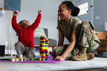 Black Mother And Daughter Celebrating And Having Fun Playing Games In Family Room At Home