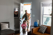 Black Soldier Brings Home Groceries With Daughter