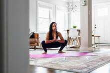 Woman Does Namaste Hands Yoga Pose